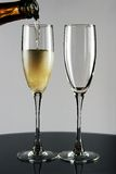 Glasses. Filling two glasses with champagne Stock Photos
