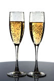 Glasses. Two glasses with champagne at table Royalty Free Stock Photography