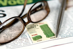 Glasses. And pen on a newspaper Stock Photos