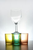 Glasses. Wine glass on top of coloured shot glasses Stock Photos