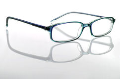 Glasses. Isolated in a white background with reflection Stock Photography