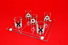 Glasses. As noughts and crosses on a red background Royalty Free Stock Photo