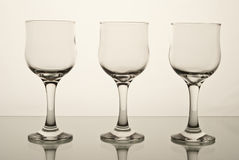 Glasses. Three elegant wine glasses siting on a table Stock Photography