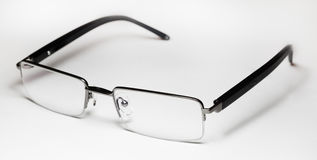 Glasses. Men's glasses on grey background Stock Images