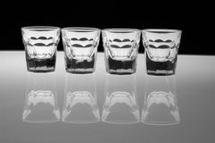 Glasses. Bottle with glasses on black and white background Royalty Free Stock Images