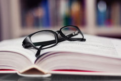 Glasses. Closeup of reading glasses on the book Royalty Free Stock Photography