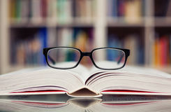 Glasses. Closeup of reading glasses on the book Stock Photos