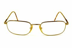Glasses. Some eye glasses facing you on a white background royalty free stock photo