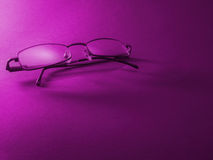 Glasses. Pink bacground Stock Images