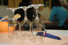 Glasses. Row og glasses for wine before starting eating in restaurant with people in background Royalty Free Stock Photography