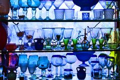 Glasses. A shelf full of glasses Royalty Free Stock Photography