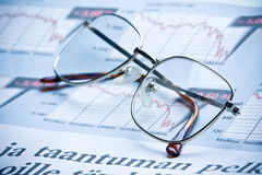 Glasses. On financial diagram. business concept Royalty Free Stock Photos