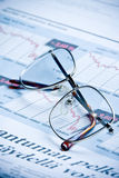 Glasses. On financial diagram. business concept Royalty Free Stock Images