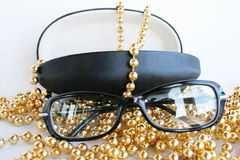 Glasses. Decorated by a yellow beads Royalty Free Stock Photos