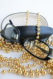 Glasses. Decorated by a yellow beads stock photo