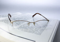 Glasses. Read Glasses on wight bool Royalty Free Stock Photos