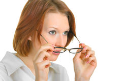 Glasses. A girl who looks forward, over glasses Stock Image
