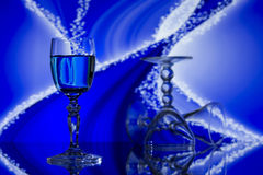 Glasses on abstract blue background Royalty Free Stock Photo