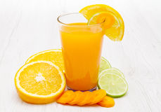 A Glasses of ace  juice with carrot,orange and lemon Royalty Free Stock Images