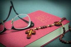 Glasses adjusted on the holy bible Stock Image