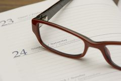 Glasses on agenda Stock Photo