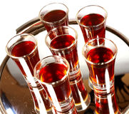 Glasses with alcohol. On a mirror Stock Photos