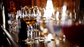 Glasses with alcohol and different drinks - wine, champagne on banquet table in a restaurant stock video footage