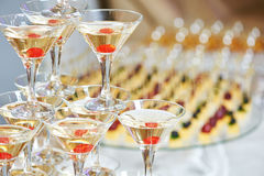 Glasses with alcohol drinks in pyramid Stock Images