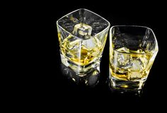 Glasses of alcoholic drink on black background royalty free stock photo