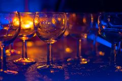 Glasses for alcoholic drinks in the rays stock photo