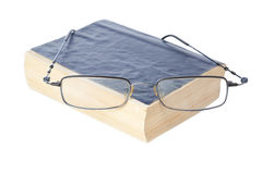 Glasses on the ancient book. Royalty Free Stock Photos