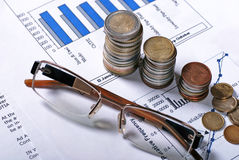 Glasses And Coins Stock Photography