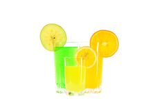Glasses of apple, orange and lemon juice with slices fruit Stock Photos