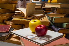 Glasses apples and old books Royalty Free Stock Image