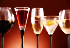 Glasses with assorted alcoholic beverages Stock Images