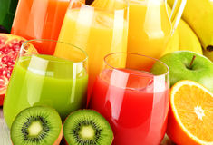 Glasses of assorted fruit juices on white. Detox diet Stock Photography