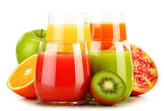 Glasses of assorted fruit juices on white. Detox diet Stock Photos