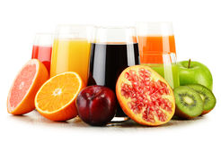 Glasses of assorted fruit juices on white. Detox diet Royalty Free Stock Photo