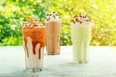 Glasses of assorted milkshakes stock photo