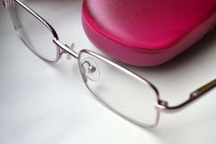 Glasses. Baby pink glasses with bright red sheath Stock Photo