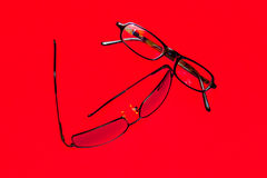 Glasses on background red Stock Photo