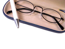 Glasses and ball-pen. Over white background Royalty Free Stock Image