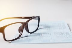 Glasses with bank account passbook for savings financial and acc. Ounting concept Stock Photo