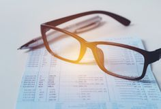 Glasses with bank account passbook for savings financial and acc. Ounting concept Royalty Free Stock Photography