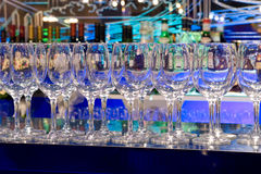 Glasses on a bar rack Royalty Free Stock Photos