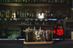 Glasses on bar table, refreshing drinks with straws. Shugar and Royalty Free Stock Photos