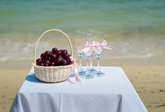 The glasses and basket with fruit at wedding ceremony Stock Images
