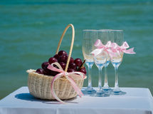 The glasses and basket with fruit at wedding ceremony Royalty Free Stock Photography