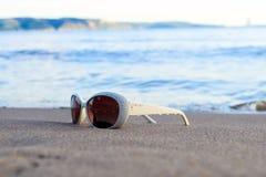 Glasses on beach Stock Photo