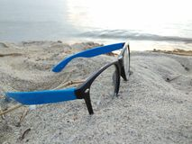 Glasses on a beach. Glasses lying on top of sands on beach near the water Stock Photography